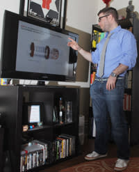 Seth Norman shows schematics of an IV device he invented in his apartment on Thursday, March 21, 2013 in Iowa City, Iowa, USA. A former U.S. Army captain, Norman began working on an IV bag that functions better in the field as a Stanford student after his military duty.