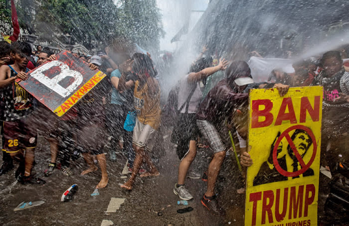 MANILA, PHILIPPINES - NOVEMBER 13: Protesters are soaked as they clash with riot police as they march the streets of Manila during the start of the ASEAN meetings between heads of state on November 13, 2017 in Manila, Philippines. Thousands of Filipinos protested in Manila as U.S. President Donald Trump's attended the ASEAN meetings in the Philippines, a stop included in his 12-day Asia trip. (Photo by Jes Aznar/Getty Images) ***BESTPIX***