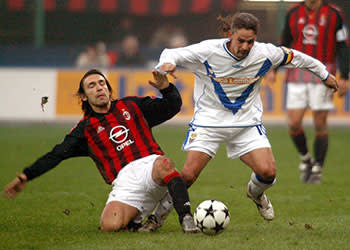 Andrea Pirlo in action for AC Milan in 2002, against Roberto Baggio