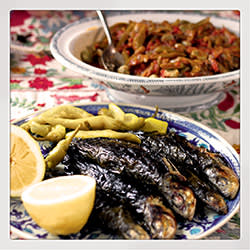 Sardines wrapped in vine leaves then barbecued