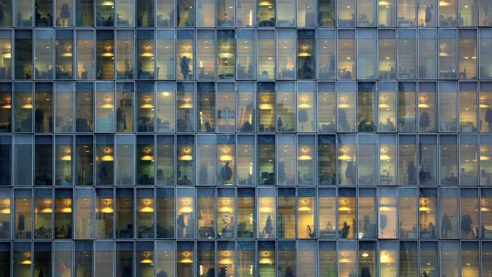 FILE PHOTO: Lights are on as people work in an office building in Milan, Italy, February 17, 2015. REUTERS/Stefano Rellandini/File Photo GLOBAL BUSINESS WEEK AHEAD - SEARCH GLOBAL BUSINESS 2 OCT FOR ALL IMAGES - RC1CA0248650