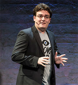 """Palmer Luckey, co-founder of Oculus VR Inc. and creator of the Oculus Rift, speaks during the Oculus VR Inc. """"Step Into The Rift"""" event in San Francisco, California, U.S., on Thursday, June 11, 2015. Facebook Inc.'s Oculus virtual-reality headsets will work with Microsoft Corp.'s Windows 10 and use the software maker's wireless Xbox game controller. Photographer: David Paul Morris/Bloomberg *** Local Caption *** Palmer Luckey"""