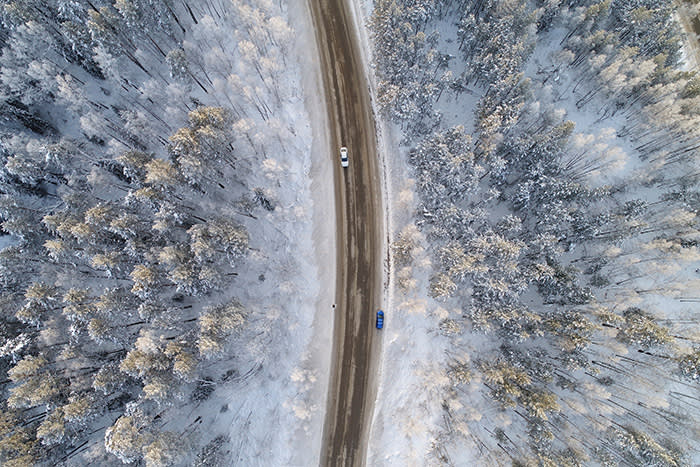 An aerial view shows a road on the banks of the Yenisei River, in air temperatures of about minus 17 degrees Celsius (1.4 degrees Fahrenheit), outside Russia's Siberian city of Krasnoyarsk, Russia, December 10, 2017. REUTERS/Ilya Naymushin TPX IMAGES OF THE DAY