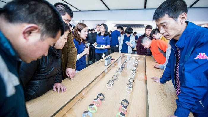 Customers look at Apple Inc. Apple Watch smartwatches displayed at an Apple Store near West Lake on April 10, 2015 in Hangzhou, Zhejiang province of China