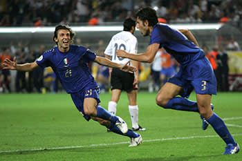 Pirlo (left), after setting up Grosso (right) for the goal that beat Germany in the 2006 World Cup semi-final