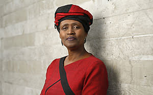 Winnie Byanyima, executive director of Oxfam International, poses for a photograph on the final day of the World Economic Forum (WEF) in Davos, Switzerland, on Saturday, Jan. 24, 2015