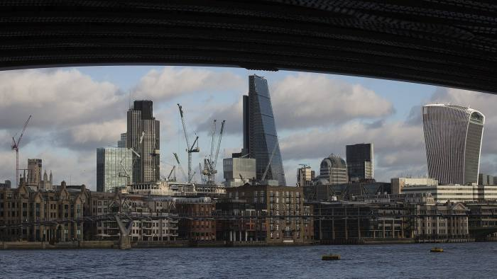 Construction cranes stand above building sites in the City Of London, near Tower 42, left, the Leadenhall building, also known as the