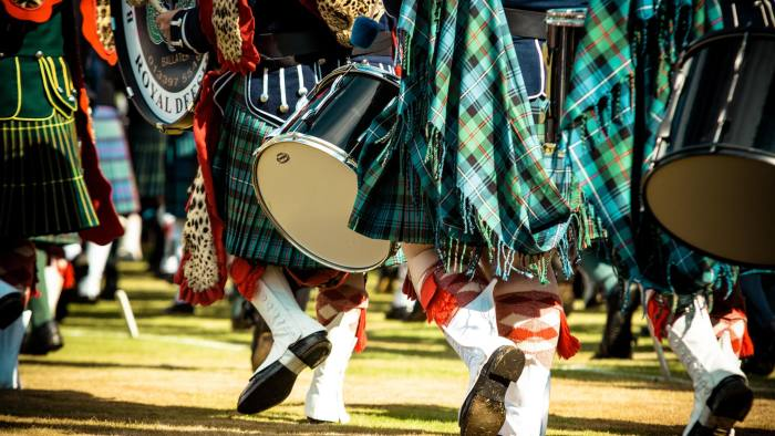 A pipe band competes marching at the annual Braemar Highland Games