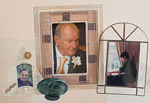 Photographs of Stephanie Shirley's husband, Derek, and their son, Giles (right), who died in 1998