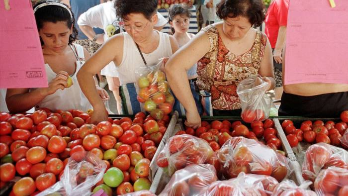 Sao Paulo residents buy tomatoes at the local open-air market in a file photo dates January 20 1999