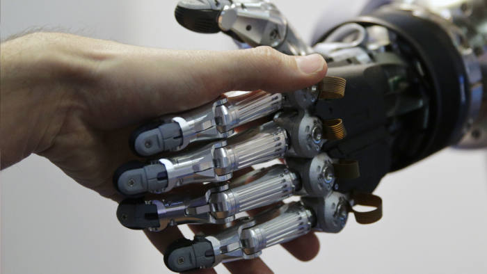 A man shakes hands with a humanoid robot during the International Conference on Humanoid Robots in Madrid...A man shakes hands with a humanoid robot during the International Conference on Humanoid Robots in Madrid November 19, 2014.  REUTERS/Andrea Comas (SPAIN - Tags: SCIENCE TECHNOLOGY) - RTR4ER01