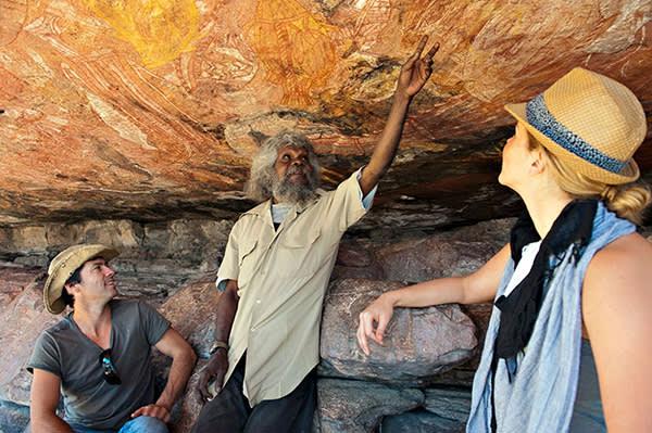 Looking at Aboriginal rock art in Arnhem Land, Australia