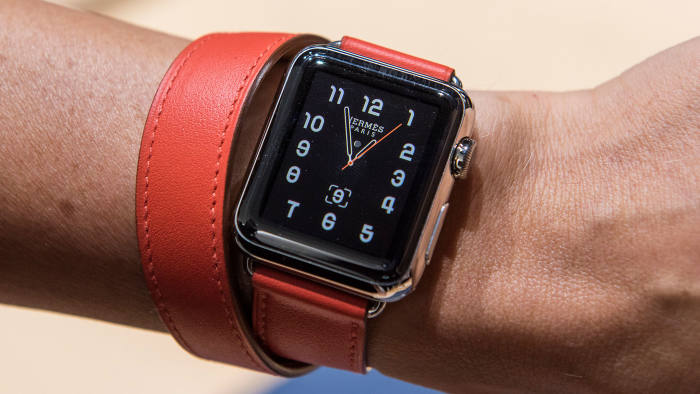 the Apple Watch, shown here with a leather strap by Hermès