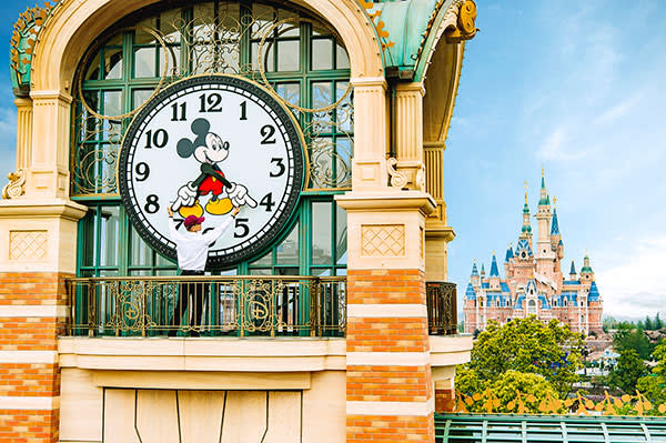 A 'cast member' sets the Mickey Avenue clock in preparations for the opening day
