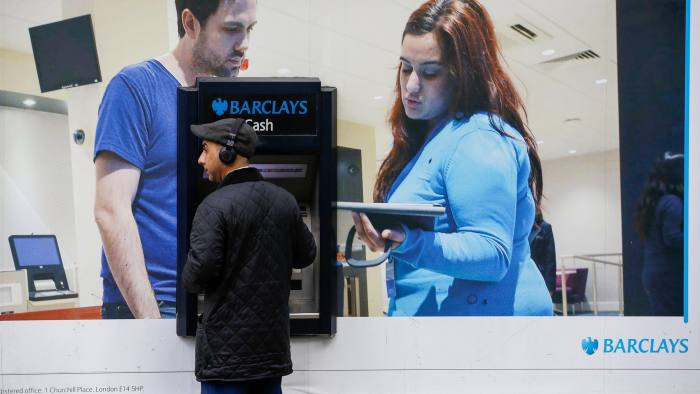 A customer uses a Barclays Plc automated teller machine (ATM) outside a branch of the bank in London, U.K., on Tuesday, March 21, 2017. Barclays is considering Dublin for their EU base to ensure continued access to the single market, said people familiar with the plans,asking not to be named because the plans aren't public. Photographer: Luke MacGregor/Bloomberg