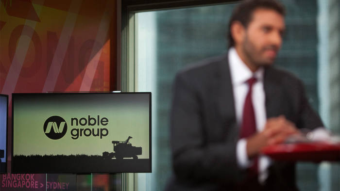 The Noble Group Ltd. logo is displayed on a screen as Yusuf Alireza, chief executive officer of Noble Group, speaks during an interview in Hong Kong, China, on Tuesday, Aug. 21, 2012. Noble Group, Asia's biggest commodity supplier, last week reported a 39 percent rise in second-quarter profit because of higher sales from energy and metals. Photographer: Jerome Favre/Bloomberg *** Local Caption *** Yusuf Alireza