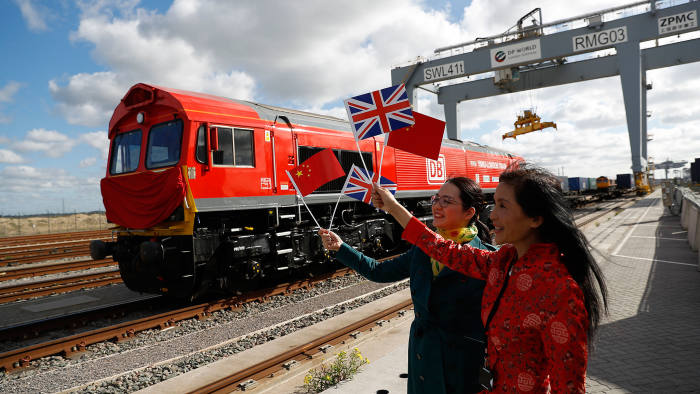 New Silk Road: Chinese women waving flags on April 10, when the first UK-to-China export train departed laden with British goods
