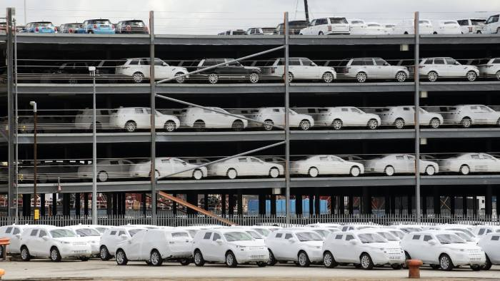 Cars wrapped for protection for export from the UK on the docks at Southampton. (Photo by: Education Images/UIG via Getty Images)