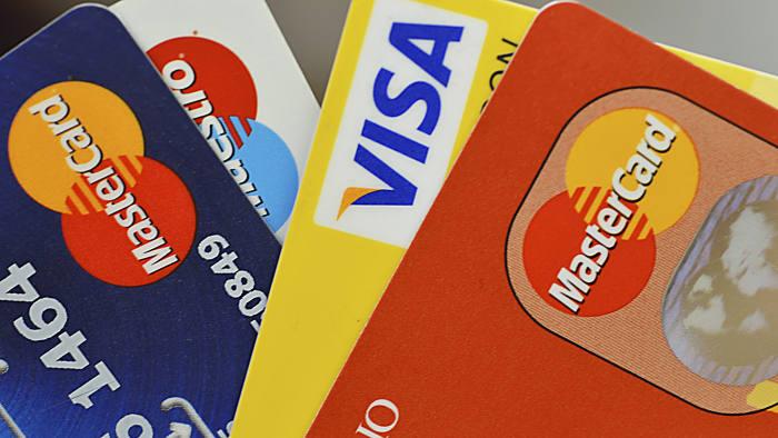 Hong Kong, China - September 22, 2013: A close up of credit cards stack including visa, master and maestro