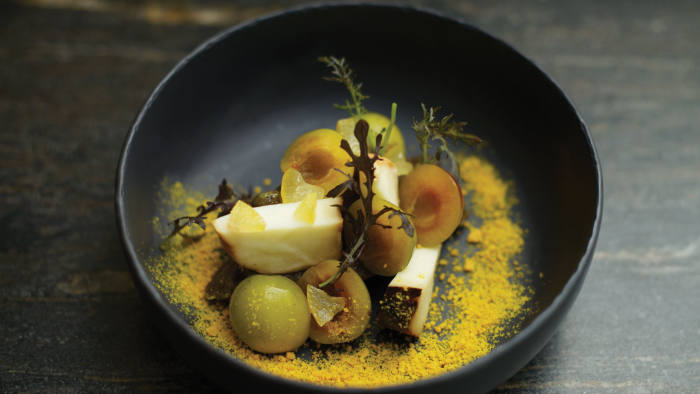 At Dessance: scamorza, mini mirabelle plums and mustard leaves
