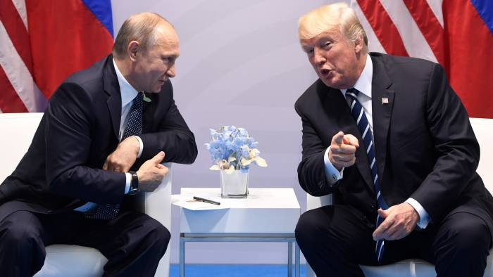 US President Donald Trump and Russia's President Vladimir Putin hold a meeting on the sidelines of the G20 Summit in Hamburg, Germany, on July 7, 2017. / AFP PHOTO / SAUL LOEB (Photo credit should read SAUL LOEB/AFP/Getty Images) *** BESTPIX ***