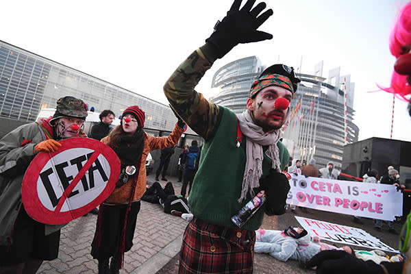 Protestors demonstrate against the Transatlantic Trade and Investment Partnership (TTIP) & EU-Canada Comprehensive Economic and Trade Agreement (CETA) in front of the European Parliament in Strasbourg, eastern France, on February 15, 2017. / AFP PHOTO / FREDERICK FLORINFREDERICK FLORIN/AFP/Getty Images