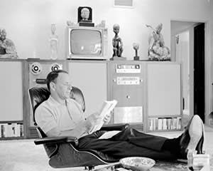 Frank Sinatra reading at home in Palm Springs, California, in 1965