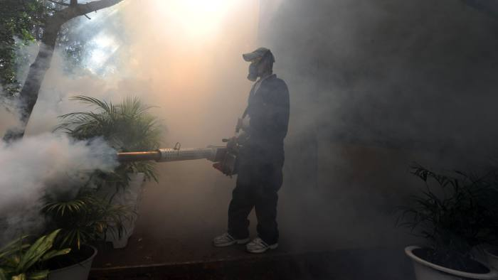 In Honduras health workers fumigate against the Aedes aegypti mosquito which carries Zika
