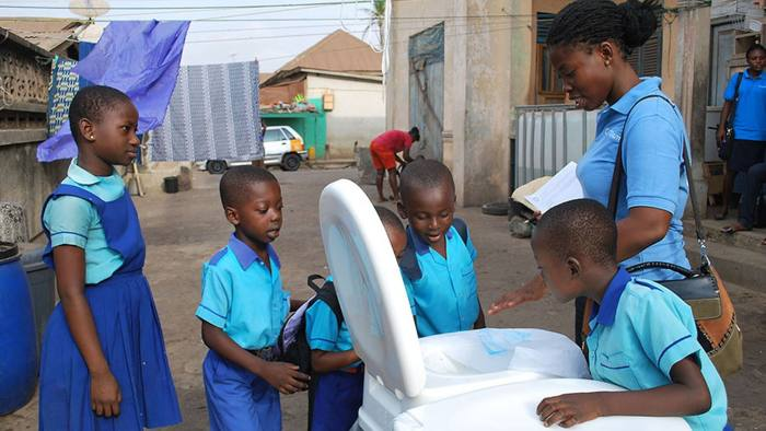 The Ideo sanitation project being explained to children in Kumasi, Ghana