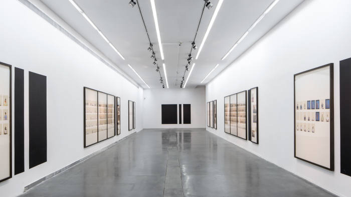 Images from 'A Living Man Declared Dead' in a gallery at the Ullens Center in Beijing, with black areas clearly visible