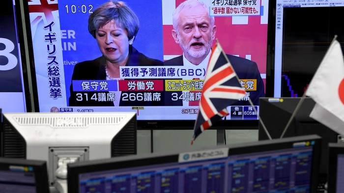 A television shows news of the British general election at a foreign currency market in Tokyo on June 9, 2017. The British pound fell sharply as an exit poll following the general elections suggested Prime Minister Theresa May's Conservative Party could lose its parliamentary majority, as the country begins sensitive Brexit negotiations. / AFP PHOTO / Toshifumi KITAMURATOSHIFUMI KITAMURA/AFP/Getty Images