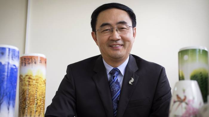 In this Jan. 26, 2016 photo, Jian Yang, a New Zealand lawmaker who was born in China, talks about his wishes for the Chinese New Year in Auckland, New Zealand. Yang said in a statement Wednesday, Sept. 13, 2017 he's loyal to his new home after media reported he'd spent a decade at top Chinese military colleges and was investigated by New Zealand's intelligence agency. (Greg Bowker/New Zealand Herald via AP)