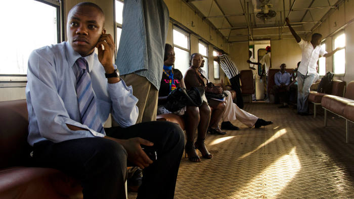 Ugandan commuters on a Rift Valley Railways service near Kampala