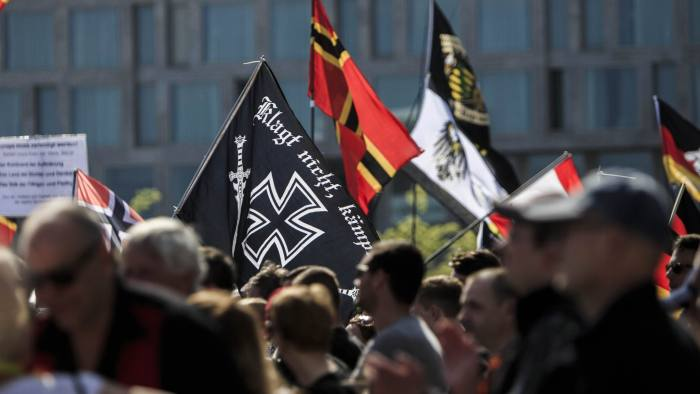 "BERLIN, GERMANY - MAY 07: Neo-Nazis and other right-wing activists gather in front of Hauptbahnhof railway station under the banner ""We for Berlin - We for Germany"" to protest against German Chancellor Angela Merkel's refugee policy on May 7, 2016 in Berlin, Germany. Germany's far-right is seeking to profit from the unease among a significant portion of Germany's population over the influx of over one million migrants and refugees in the past year. (Photo by Carsten Koall/Getty Images)"
