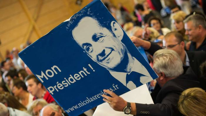 A supporter holds a poster of former Fre...A supporter holds a poster of former French President' during a speech of the latter on September 25, 2014 at a rally in the northern city of Lambersart, six days after he announced his political comeback. Nicolas Sarkozy held his first meeting in Lambersart, hoping again to take over in two months time as chief of his UMP party (L'Union pour un mouvement populaire) which is fractured by dissent. A corruption and influence-peddling investigation launched in July against the former French president was suspendedafter he anounced his political comeback. AFP PHOTO PHILIPPE HUGUENPHILIPPE HUGUEN/AFP/Getty Images