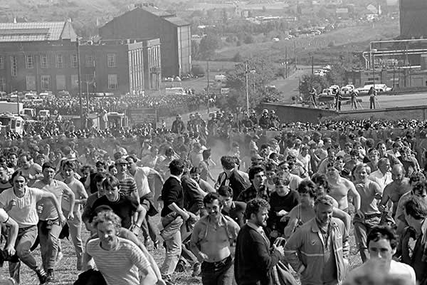 June 18 1984: miners run from the police at the Orgreave coking plant near Rotherham