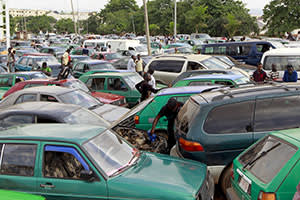 A bumper to bumper queue for petrol in Abuja during a chronic fuel shortage in May