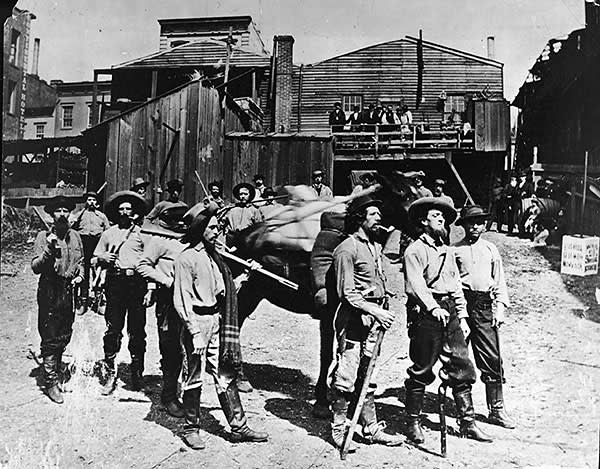 Gold rush prospectors — some bearing arms — in the US north-west