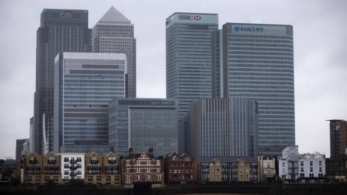 An exterior view shows the headquarters building of Barclays Bank, 1 Churchill Place, at right, in the Canary Wharf business district of London, Thursday, May 8, 2014.  British bank Barclays says it will cut around 14,000 jobs this year as it looks to streamline its operations and reduce the size of its investment banking arm.  The figure was higher than anticipated — previously the bank had indicated that it was looking to get rid of between 10,000 and 12,000 people.  (AP Photo/Matt Dunham)