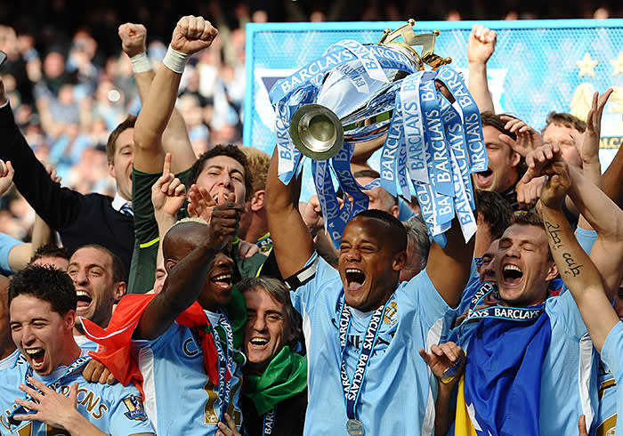 Manchester City's Belgian captain Vincent Kompany lifts the Premier league trophy after their 3-2 victory over Queens Park Rangers in the English Premier League football match between Manchester City and Queens Park Rangers at The Etihad stadium in Manchester, north-west England on May 13, 2012. Manchester City won the game 3-2 to secure their first title since 1968. This is the first time that the Premier league title has been decided on goal-difference, Manchester City and Manchester United both finishing on 89 points. AFP PHOTO/PAUL ELLIS RESTRICTED TO EDITORIAL USE. No use with unauthorized audio, video, data, fixture lists, club/league logos or 'live' services. Online in-match use limited to 45 images, no video emulation. No use in betting, games or single club/league/player publications. (Photo credit should read PAUL ELLIS/AFP/GettyImages)