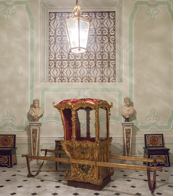 An 18th-century, gold sedan chair that pop star Madonna loves to sit in whenever she visits