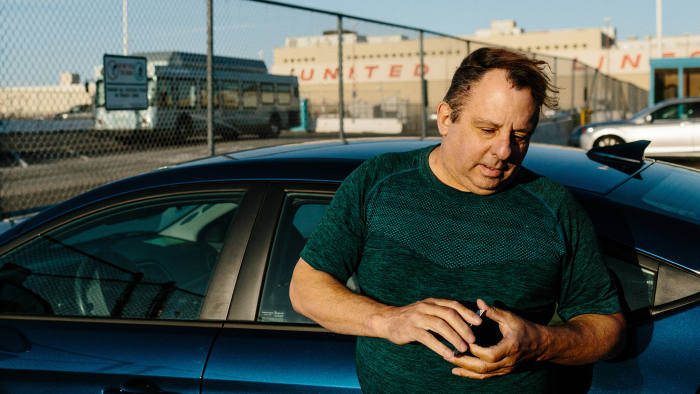 Former cab driver turned Uber driver Victor Liuzzi at the TNC airport waiting lot for Uber and Lyft drivers in San Francisco, Calif., Sunday October 1, 2017.