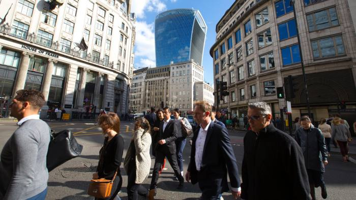 H3BPC6 City workers cross the road overlooked by 20 Fenchurch Street known as the 'Walkie Talkie' building, nearby London Bridge, UK