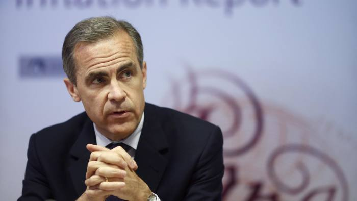 Mark Carney, governor of the Bank of England, speaks during the central bank's quarterly inflation report news conference at the Bank of England in London, U.K., on Wednesday, May 14, 2014. The Bank of England signaled it's willing to wait until next year to raise interest rates even as the U.K. economy strengthens and the amount of spare capacity narrows. Photographer: Simon Dawson/Bloomberg *** Local Caption *** Mark Carney