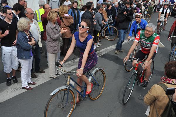 A biker dressed in vintage clothes participates in the Anjou Vélo Vintage
