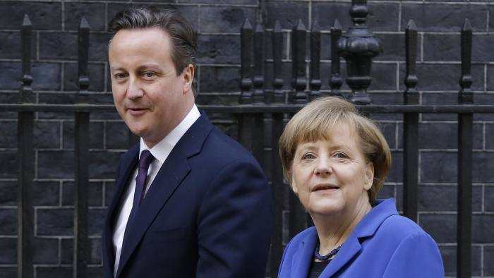Britain's Prime Minister David Cameron greets Germany's Chancellor Angela Merkel at Downing Street in London, Thursday, Feb. 27, 2014. (AP Photo/Kirsty Wigglesworth)