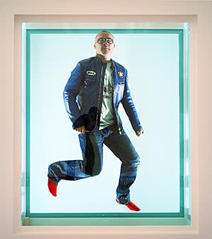 Artist, Damien Hirst, photographed in a formaldehyde tank in the White Cube Gallery, St.James, London