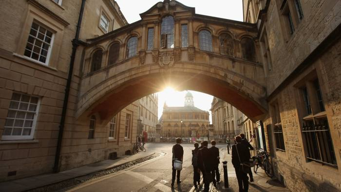 London 2012 - UK Landmarks - Oxford...OXFORD, ENGLAND - MARCH 22: Students walk under the Bridge of Sighs along New College Lane on March 22, 2012 in Oxford, England. (Photo by Oli Scarff/Getty Images)