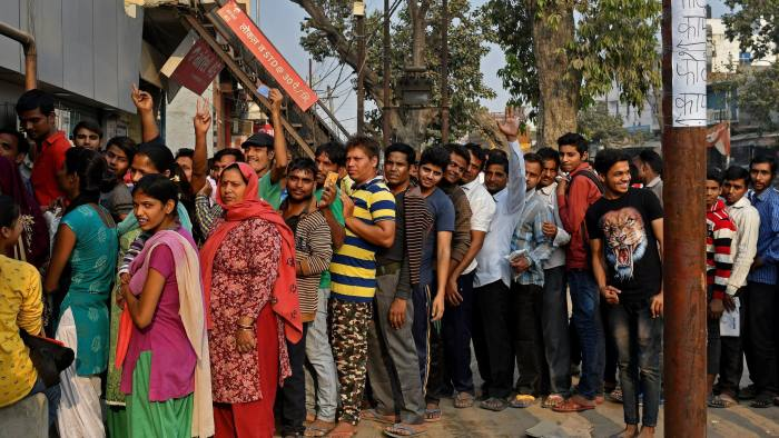 Customers wait in line to exchange Indian five hundred and one thousand rupee banknotes at a bank in Dadri, Uttar Pradesh, India, on Tuesday, Nov. 15, 2016. Over a week since Prime Minister Narendra Modi shocked the nation with the withdrawal of large denomination notes there was no sign the government had managed to print enough notes to replace its withdrawal of 86 per cent of currency in circulation. Photographer: Anindito Mukherjee/Bloomberg