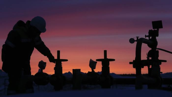 A worker checks the valve of an oil pipe at an oil field owned by Bashneft company near Nikolo-Berezovka...A worker checks the valve of an oil pipe at an oil field owned by Bashneft company near the village of Nikolo-Berezovka, northwest from Ufa, Bashkortostan, January 28, 2015. New European Union sanctions against Russia could include further capital markets restrictions, making it harder for Russian companies to refinance themselves and possibly affecting Russian sovereign bonds and access to advanced technology for the oil and gas sectors, EU officials said on Wednesday. REUTERS/Sergei Karpukhin (RUSSIA - Tags: ENERGY BUSINESS INDUSTRIAL POLITICS)